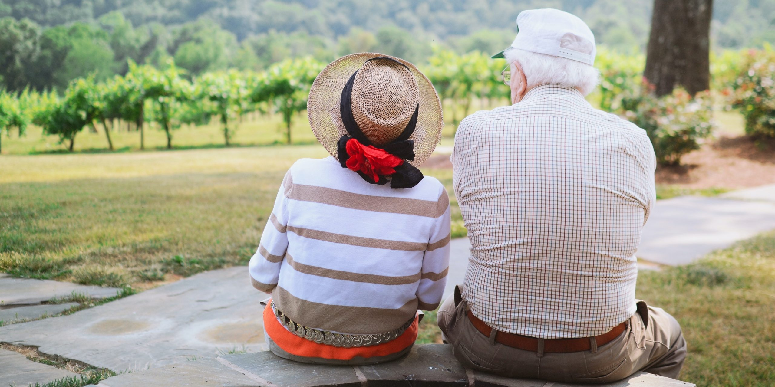 Elderly couple protected from the sun